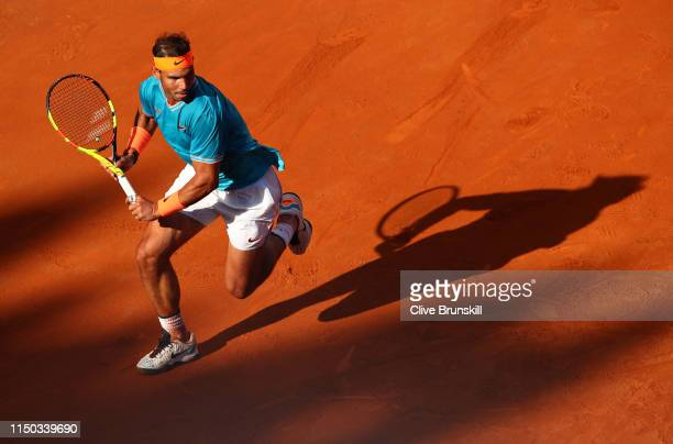 Rafael Nadal of Spain runs to play a backhand against Novak Djokovic of Serbia in the mens final during day eight of the International BNL d'Italia...