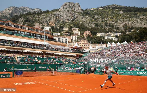 Rafael Nadal of Spain runs to play a forehand against Marinko Matosevic of Australia in their second round match during day four of the ATP Monte...