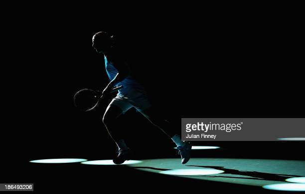 Rafael Nadal of Spain runs to the baseline as he begins his warm up against Jerzy Janowicz of Poland during day four of the BNP Paribas Masters at...