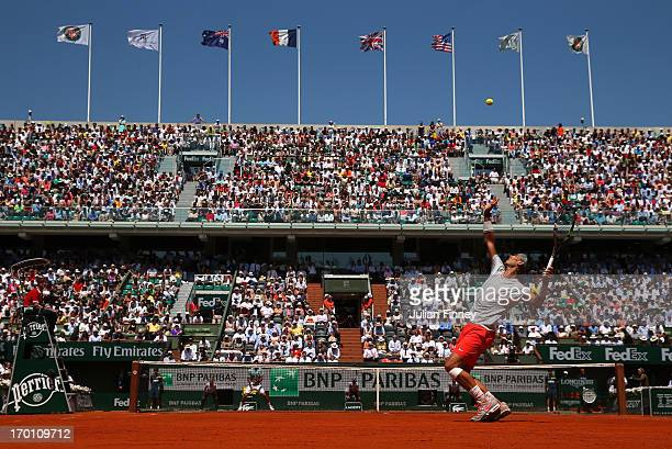Rafael Nadal of Spain serrves during the men's singles semi-final match against Novak Djokovic of Serbia on day thirteen of the French Open at Roland...