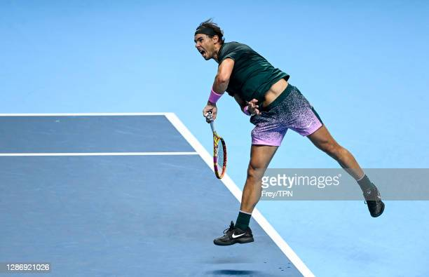 Rafael Nadal of Spain serves against Daniil Medvedev of Russia during Day 7 of the Nitto ATP World Tour Finals at The O2 Arena on November 21, 2020...