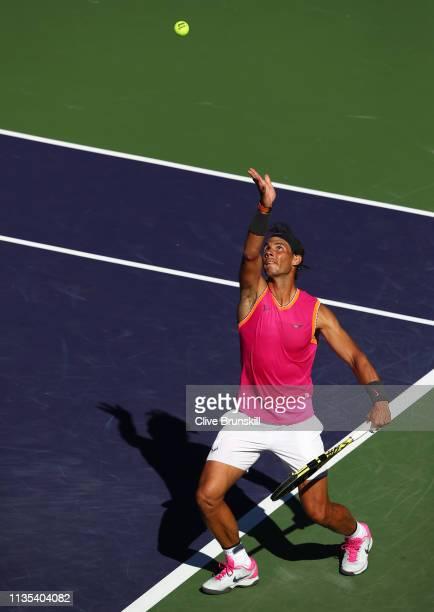 Rafael Nadal of Spain serves against Diego Schwartzman of Argentina during their men's singles third round match on day nine of the BNP Paribas Open...