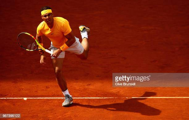 Rafael Nadal of Spain serves against Dominic Thiem of Austria in their quarter final match during day seven of the Mutua Madrid Open tennis...