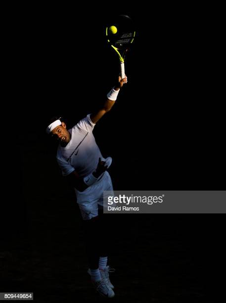 Rafael Nadal of Spain serves against Donald Young of United States during the Gentlemen's Singles second round match on day three of the Wimbledon...