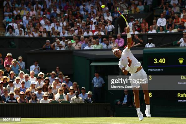 Rafael Nadal of Spain serves against Dudi Sela of Isreal during his Men's Singles first round match against on day two of the Wimbledon Lawn Tennis...