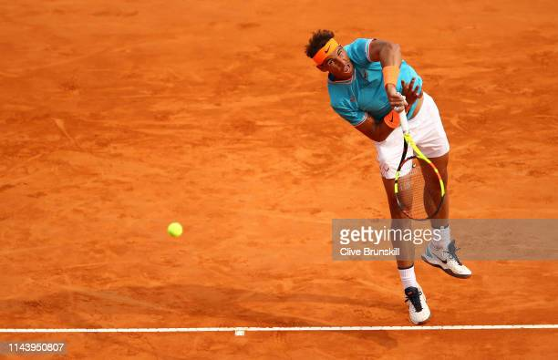 Rafael Nadal of Spain serves against Fabio Fognini of Italy in their semifinal match during day seven of the Rolex Monte-Carlo Masters at Monte-Carlo...