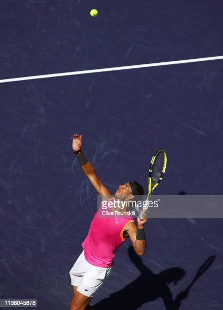 Rafael Nadal of Spain serves against Karen Khachanov of Russia during their men's singles quarter final match on day twelve of the BNP Paribas Open...