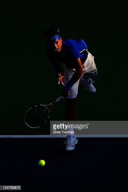 Rafael Nadal of Spain serves against Novak Djokovic of Serbia during the Men's Final on Day Fifteen of the 2011 US Open at the USTA Billie Jean King...