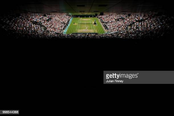 Rafael Nadal of Spain serves against Novak Djokovic of Serbia during their Men's Singles semifinal match on day twelve of the Wimbledon Lawn Tennis...