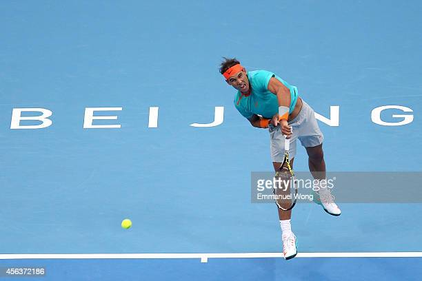 Rafael Nadal of Spain serves against Richard Gasquet of France during day four of the China Open at the China National Tennis Center on September 30...