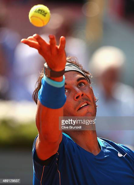 Rafael Nadal of Spain serves against Roberto Bautista Agut of Spain in their semi final match during day eight of the Mutua Madrid Open tennis...