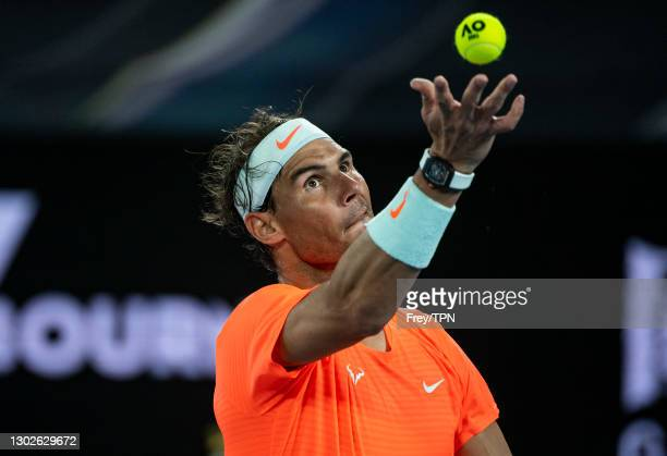 Rafael Nadal of Spain serves against Stefanos Tsitsipas of Greece during day 10 of the 2021 Australian Open at Melbourne Park on February 17, 2021 in...