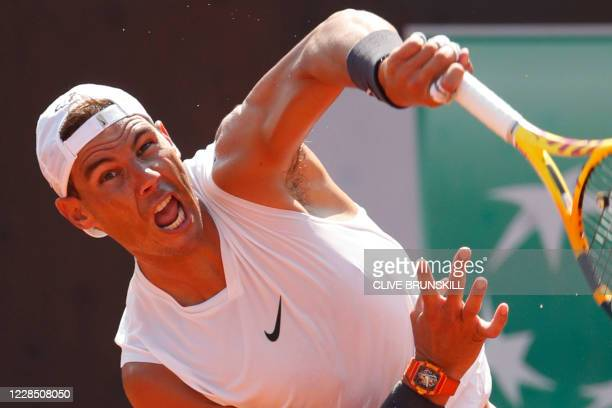 Rafael Nadal of Spain serves during a practice session on day one of the Italian Open at Foro Italico on September 14, 2020 in Rome, Italy.