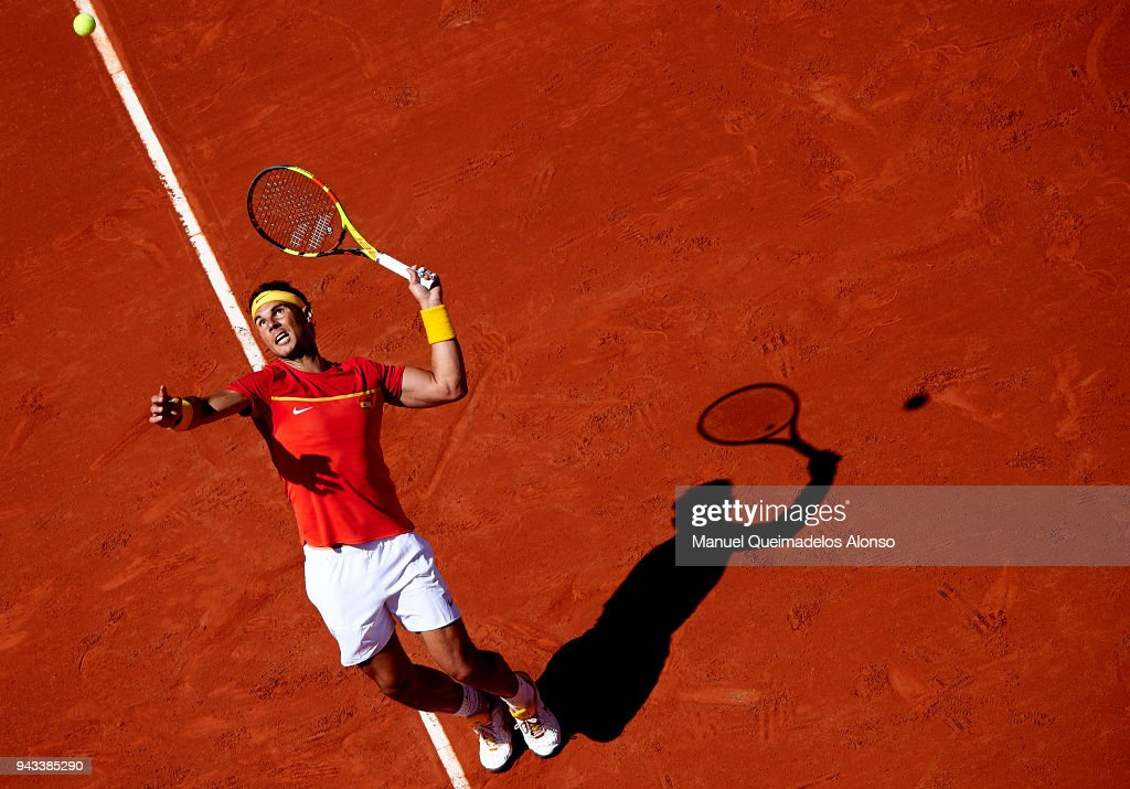Rafael Nadal of Spain serves during his match against Alexander Zverev of Germany during day three of the Davis Cup World Group Quarter Final match between Spain and Germany at Plaza de Toros de Valencia on April 8, 2018 in Valencia, Spain.