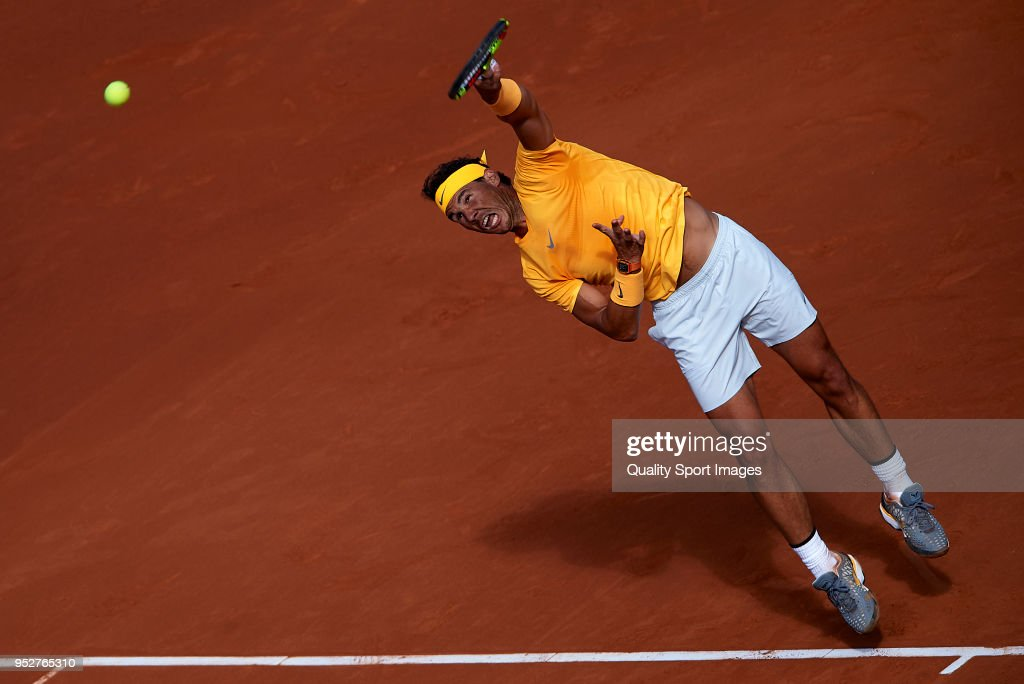 Rafael Nadal of Spain serves during his match against Stefanos Tsitsipas of Greece during day seventh of the ATP Barcelona Open Banc Sabadell at the Real Club de Tenis Barcelona on April 29, 2018 in Barcelona, Spain.