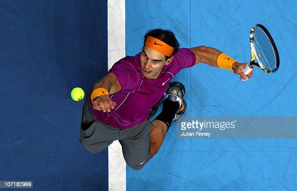 Rafael Nadal of Spain serves during his men's final match against Roger Federer of Switzerland during the ATP World Tour Finals at O2 Arena on...