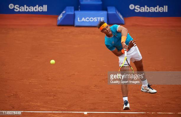 Rafael Nadal of Spain serves during his Men's round of 16 match against David Ferrer of Spain on day four of the Barcelona Open Banc Sabadell at Real...