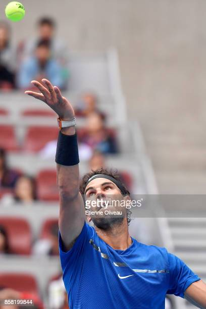 Rafael Nadal of Spain serves during his Men's singles quarterfinal match against John Isner of the United States on day seven of the 2017 China Open...