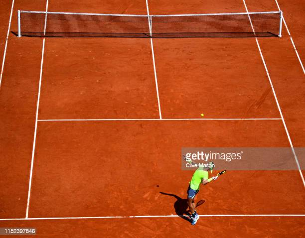 Rafael Nadal of Spain serves during his mens singles second round match against Yannick Maden of Germany during Day four of the 2019 French Open at...