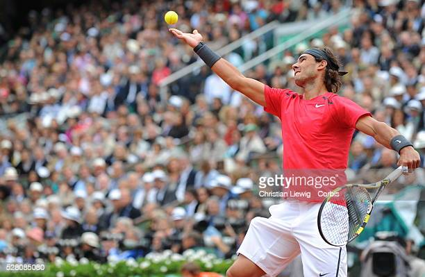 PARIS FRANCE JUNE 10 Rafael Nadal of Spain serves during the men's singles final against Novak Djokovic of Serbia on day 15 of the French Open at...
