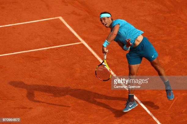 Rafael Nadal of Spain Serves during the mens singles final against Dominic Thiem of Austria during day fifteen of the 2018 French Open at Roland...