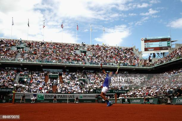 Rafael Nadal of Spain serves during the mens singles final match against Stan Wawrinka of Switzerland on day fifteen of the 2017 French Open at...