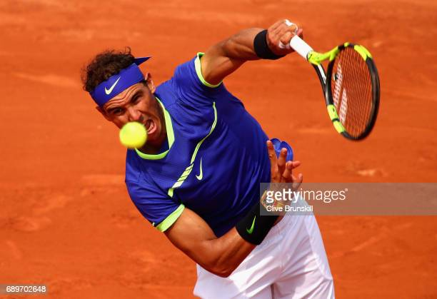 Rafael Nadal of Spain serves during the mens singles first round match against Benoit Paire of France on day two of the 2017 French Open at Roland...