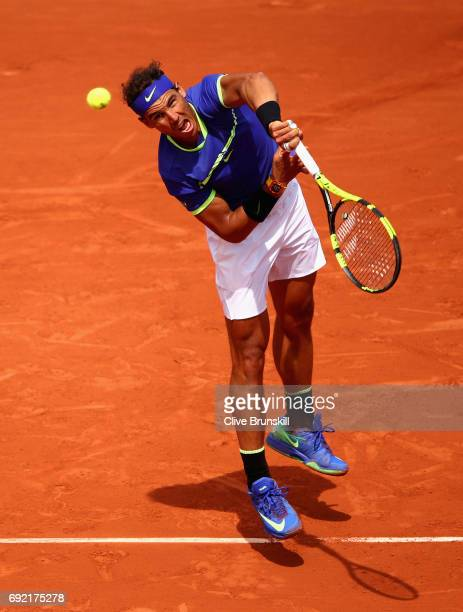 Rafael Nadal of Spain serves during the mens singles fourth round match against Roberto Bautista Agut of Spain on day eight of the 2017 French Open...