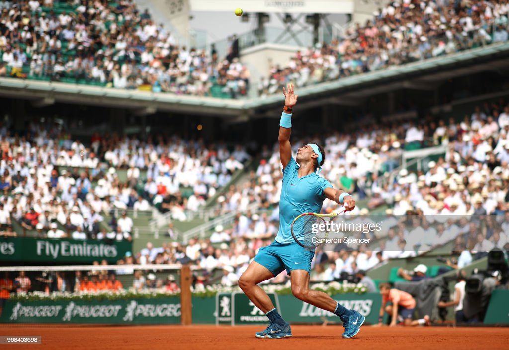 Rafael Nadal of Spain serves during the mens singles quarter finals match against Diego Schwartzman of Argentina during day eleven of the 2018 French Open at Roland Garros on June 6, 2018 in Paris, France.