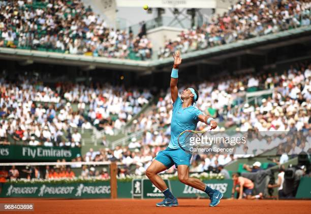 Rafael Nadal of Spain serves during the mens singles quarter finals match against Diego Schwartzman of Argentina during day eleven of the 2018 French...