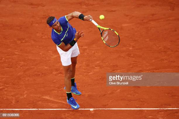 Rafael Nadal of Spain serves during the men's singles third round match against Nikoloz Basilashvili of Georgia on day six of the 2017 French Open at...