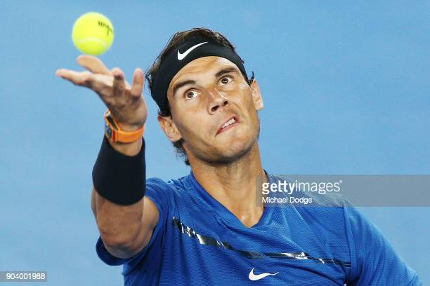 Rafael Nadal of Spain serves in during a practice match against Dominic Thiem of Austria ahead of the 2018 Australian Open at Melbourne Park on...