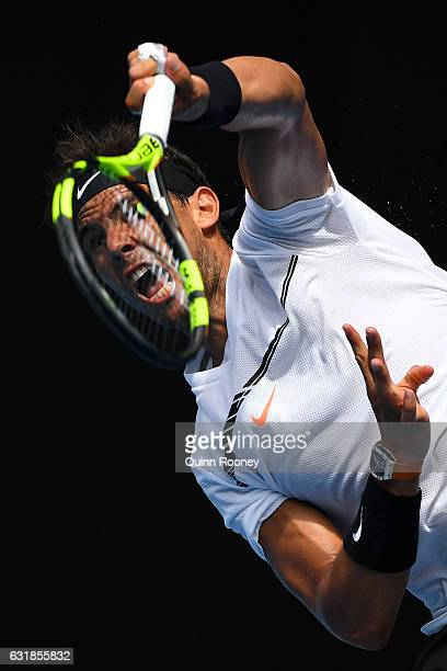 Rafael Nadal of Spain serves in his first round match against Florian Mayer of Germany on day two of the 2017 Australian Open at Melbourne Park on...