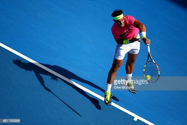 Rafael Nadal of Spain serves in his first round match against Mikhail Youzhny of Russia during day one of the 2015 Australian Open at Melbourne Park...