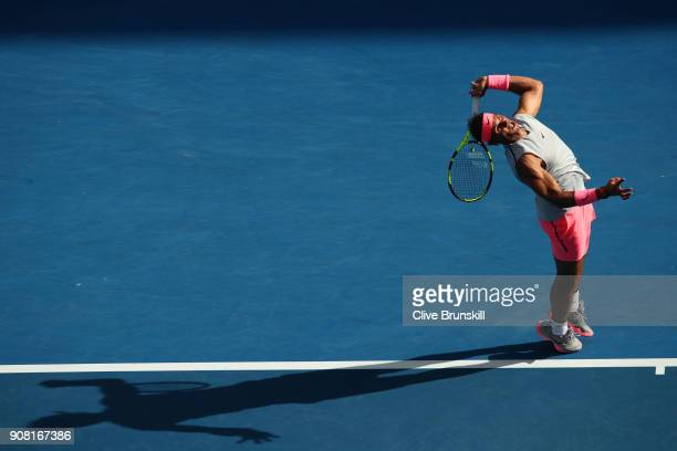Rafael Nadal of Spain serves in his fourth round match against Diego Schwartzman of Argentina on day seven of the 2018 Australian Open at Melbourne...