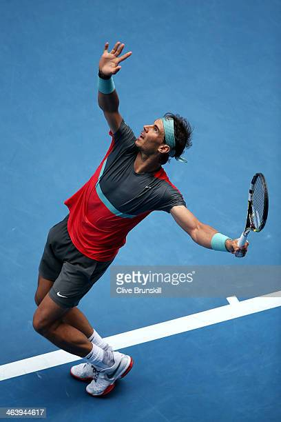 Rafael Nadal of Spain serves in his fourth round match against Kei Nishikori of Japan during day eight of the 2014 Australian Open at Melbourne Park...