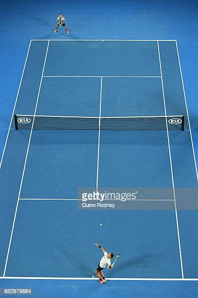 Rafael Nadal of Spain serves in his Men's Final match against Roger Federer of Switzerland on day 14 of the 2017 Australian Open at Melbourne Park on...