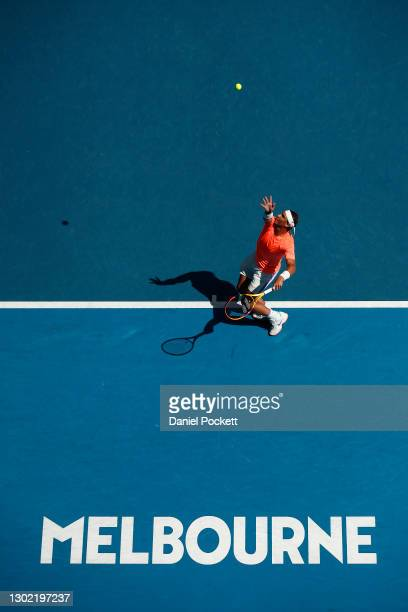 Rafael Nadal of Spain serves in his Men's Singles fourth round match against Fabio Fognini of Italy during day eight of the 2021 Australian Open at...
