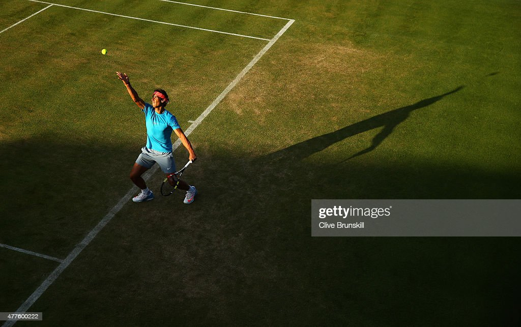 Rafael Nadal of Spain serves partnering Marc Lopez of Spain in their men's doubles quarter-final match against Daniel Nestor of Canada and Leander Paes of India during day four of the Aegon Championships at Queen's Club on June 18, 2015 in London, England.