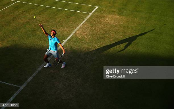 Rafael Nadal of Spain serves partnering Marc Lopez of Spain in their men's doubles quarterfinal match against Daniel Nestor of Canada and Leander...