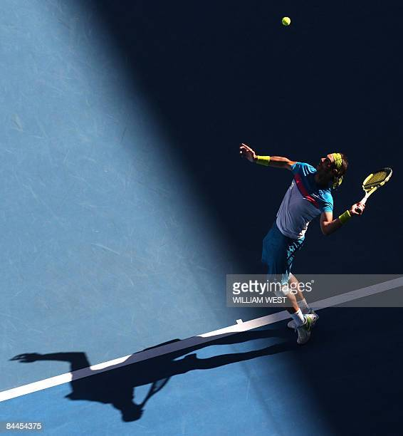 Rafael Nadal of Spain serves the ball in his game against Fernando Gonzalez of Chile during their men's tennis match on day eight of the Australian...