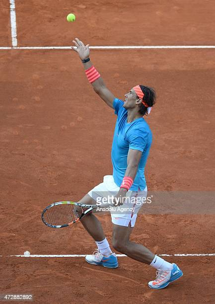 Rafael Nadal of Spain serves the ball to Andy Murray of Great Britain during their men's singles final match at the Mutua Madrid Open tennis...