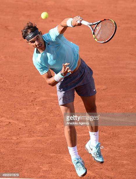 Rafael Nadal of Spain serves the ball to his compatriot David Ferrer during their quarter final match of the French Open tennis tournament at Roland...