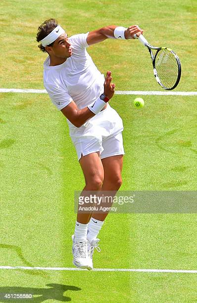 Rafael Nadal of Spain serves the ball to Lukas Rosol of Czech Republic during their men's singles second round match on day four of the 2014...