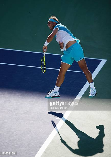 Rafael Nadal of Spain serves to Alexander Zverev of Germany at the BNP Paribas Open at the Indian Wells Tennis Garden in Indian Wells California on...