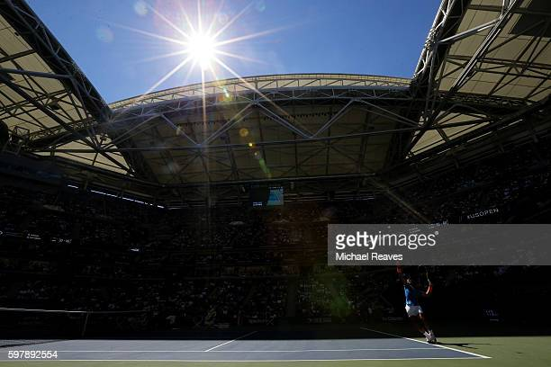 Rafael Nadal of Spain serves to Denis Istomin of Uzbekistan during his first round Men's Singles match on Day One of the 2016 US Open at the USTA...