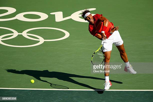 Rafael Nadal of Spain serves to Juan Martin Del Potro of Argentina during the Men's Singles Semifinal Match on Day 8 of the Rio 2016 Olympic Games at...