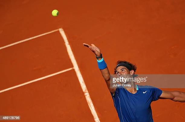Rafael Nadal of Spain serves to Roberto Bautista Agut of Spain during day eight of the Mutua Madrid Open tennis tournament at the Caja Magica on May...