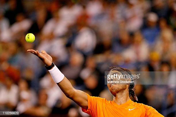 Rafael Nadal of Spain serves to Somdev Devvarman of India during the BNP Paribas Open at the Indian Wells Tennis Garden on March 16, 2011 in Indian...