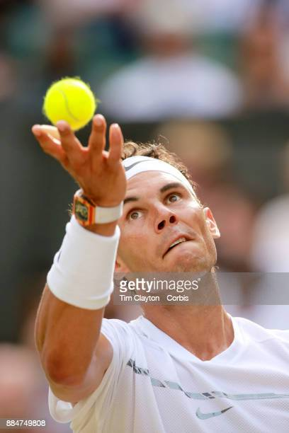 Rafael Nadal of Spain serving against Karen Khachanov of Russia in the Gentlemen's Singles competition on Centre Court during the Wimbledon Lawn...